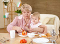 Free Grandmother Feeding Granddaughter At Home Royalty Free Stock Photography - 17935047