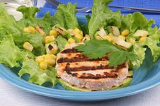 Grilled Salmon And Zucchini With Salad And Corn Stock Photo