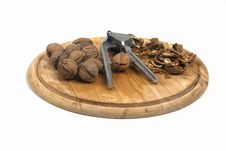 Free Nutcracker With Nuts On A Wooden Plate Stock Photography - 17932312