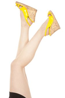 Woman Legs Apart Yellow Shoes Stock Images