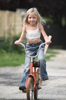 Free Young Girl Rides Her Bicylce Stock Photo - 17933410