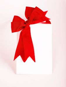 Free Beautiful Red Bow Over Blank Card Royalty Free Stock Images - 17934659