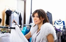 Free Young Woman In A Shop Buying Clothes Royalty Free Stock Photography - 17935067