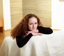 A Girl Sitting On The Sofa At Home Stock Images