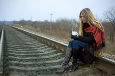 Free The Girl With A Cup Sits On Rails Stock Image - 17935491