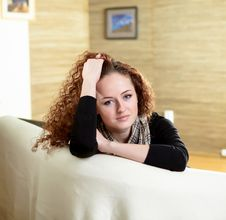 A Girl Sitting On The Sofa At Home Royalty Free Stock Images