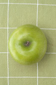 Fresh Green Apple On A Green Background Royalty Free Stock Photos