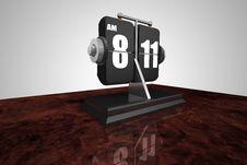 Flip Clock On A Burl Wood Desk Royalty Free Stock Photos