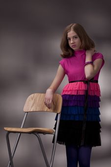 Free Portrait Of The Brunette On A High Chair Royalty Free Stock Images - 17950349