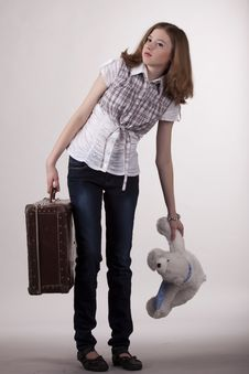 Free The Girl Is With A Heavy Suitcase Royalty Free Stock Photo - 17950565