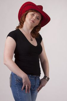 Free Portrait Of The Woman In A Red Cowboy S Hat Stock Photo - 17950610