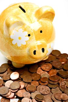 Free Yellow Ceramic Piggy Bank On A Pile Of Cents Stock Image - 17953091
