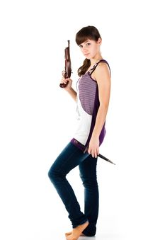 Free Beautiful Girl With A Gun And Knife Posing Royalty Free Stock Images - 17953999