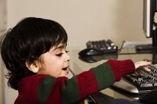 Little Boy Working On A Computer. Stock Image