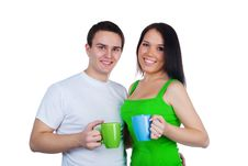 Free Young Couple With A Cups Of Tea Royalty Free Stock Image - 17954726
