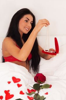 Free Girl Lying In Bed With Gifts, Heart, Jewelry, Rose Royalty Free Stock Image - 17956026