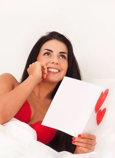 Free Girl Lying In Bed With Gifts, Cards, Hearts Stock Image - 17956041