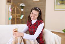 A Young Girl With A Glass Of Wine At Home Royalty Free Stock Image