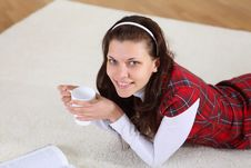 A Young Girl With A Mug Top At Home Stock Photo