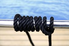 Black Sailing Rope On The Metal Pipe Royalty Free Stock Image