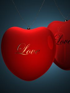 Two Red Heart Pendents With Gold Inscription Love Stock Photography