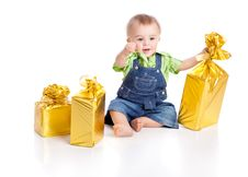 Small Boy With Three Gifts In Bright Packaging