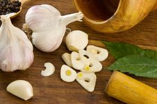 Set Of Garlic And Spice On Wood Royalty Free Stock Images