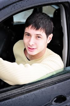 Happy Young Man Smiling From His Car Stock Photo