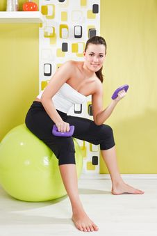 Free Young Girl Behooves Gym Exercise With Ball Royalty Free Stock Images - 17971779
