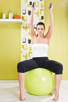 Free Young Girl Behooves Gym Exercise With Ball Royalty Free Stock Photography - 17971787