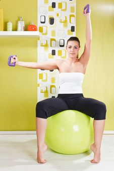 Free Young Girl Behooves Gym Exercise With Ball Royalty Free Stock Photos - 17971788