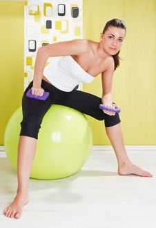 Free Young Girl Behooves Gym Exercise With Ball Stock Photography - 17971792