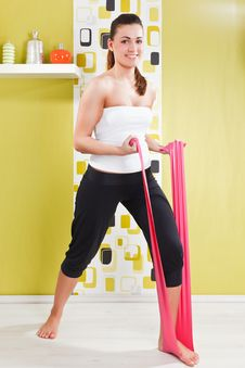 Free Young Girl Behooves Gym Exercise With Rubb Royalty Free Stock Image - 17971796