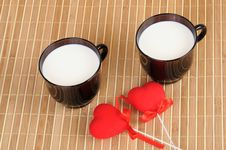 Two Cups With Milk And Hearts Royalty Free Stock Images