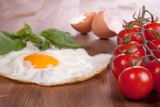 Fried Egg With Tomato Stock Images