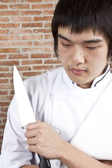 Chef Hold A Knife. Royalty Free Stock Photo