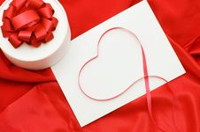 Box With A Gift On A Red Fabric Royalty Free Stock Images