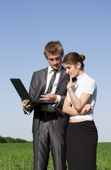 Free Two Successful Workers In The Street With A Laptop Royalty Free Stock Images - 17974109