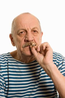 Free Elderly Man In A Stripped Vest Smokes Stock Images - 17974144