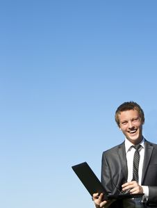 Free Young Business Man With A Laptop On Street Stock Photography - 17974212