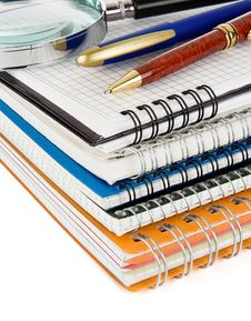 Pen And Pencil On Notebook Isolated On White Royalty Free Stock Photos