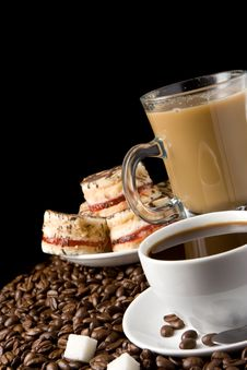 Free Cup Of Coffee And Sweets On Beans Royalty Free Stock Photo - 17975675