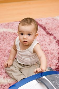 Cute Caucasian Baby With Vacuum Cleaner Royalty Free Stock Photography