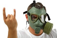 Man In Gas Mask Showing Sign Stock Photo
