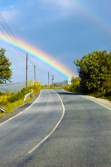 View At The Rainbow Above The Road Royalty Free Stock Photography