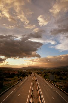 Free Cloudy Sunset Over Highway Royalty Free Stock Photography - 17981747