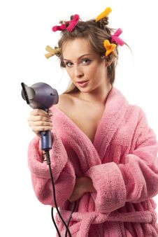 Free Girl In Pink Dressing Gown With Blue Hairdryer Stock Photos - 17984913
