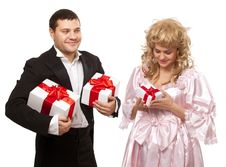 Free Victorian Couple With Gift Boxes Stock Image - 17984941