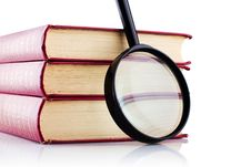 Free Old Books With A Loupe On White Background. Royalty Free Stock Images - 17985579