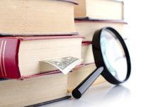 Free Old Books With A Loupe On White Background. Royalty Free Stock Photo - 17986255